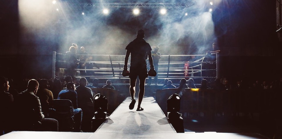 A fighter walking into the ring